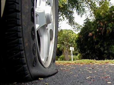 If you can't stop (or are afraid to), calling for help could mean a lot to a family with a flat tire on the highway!