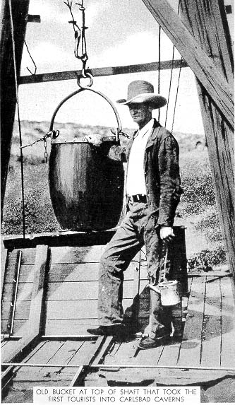 Jim Larkin White with his homemade kerosene lantern, he use the bucket to mine bat guano out of Carlsbad Caverns around 1900. He would also send people down in it to view the Caverns.