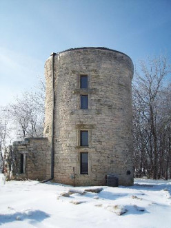 History of American Towns- Stone City, Iowa a stone water tower and Paintings of Grant Wood