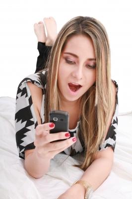 Shocked teen looking at her phone