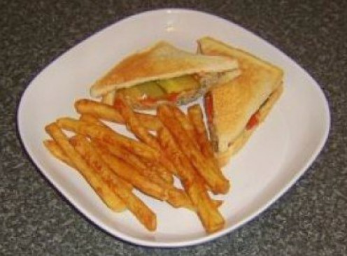 Cheeseburger themed toasted cheese sandwich with fries