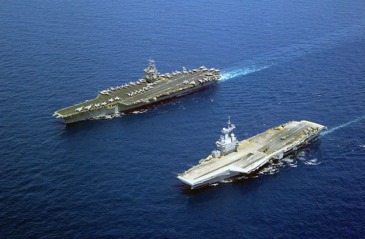 French nuclear-powered aircraft carrier Charles de Gaulle (right) and the American nuclear-powered carrier USS Enterprise