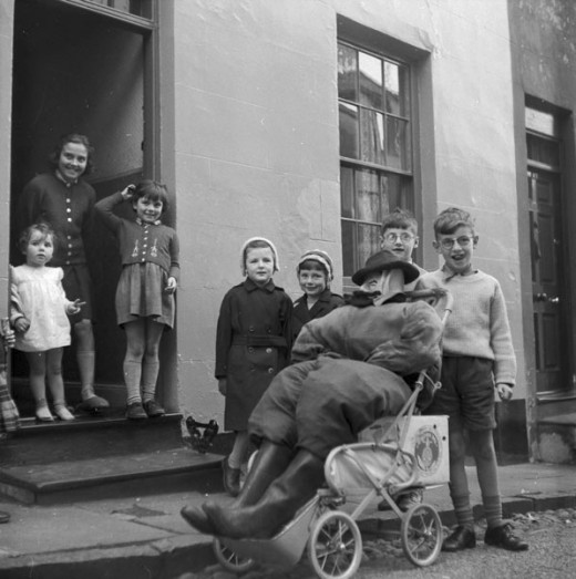 Children with their 'guy' in a pushchair ready to tour the streets to ask for 'a penny for the guy'.