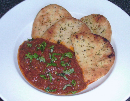 Hot and spicy kangaroo curry with mini garlic and coriander/cilantro naan breads