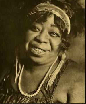 "Often performing on Beale Street,""The Home of the Blues,"" in Memphis, Tennessee; Ma Rainey was known for her music and for brawling.  She was also said to be a practitioner of hoodoo magic."