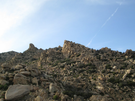 The boulders become denser on the hike towards the top of this peak.