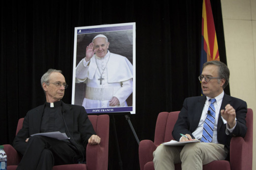 Jesuit Father Thomas Reese (left) and columnist Michael Gerson take part in a forum on economic justice