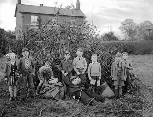 Children getting ready to put their 'guy' on top of the bonfire.