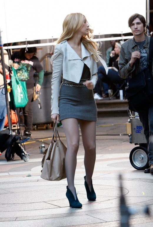 Blake Lively on set filming Gossip Girl in a short dress and high heels