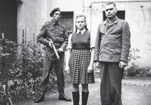 British soldier guards Josef Kramer and one of his concentration camp wardens Irma Grese