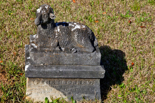 A lamb was typically placed on a child's grave as it represented purity and innocence.