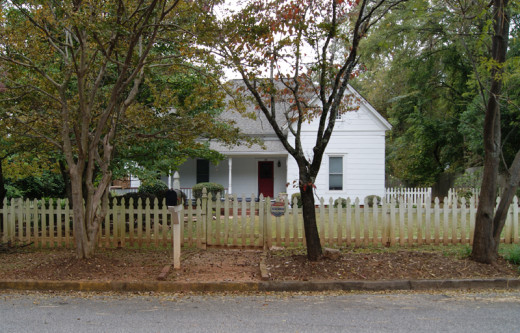 This low picket fence makes an effective foreground for the front yard landscape