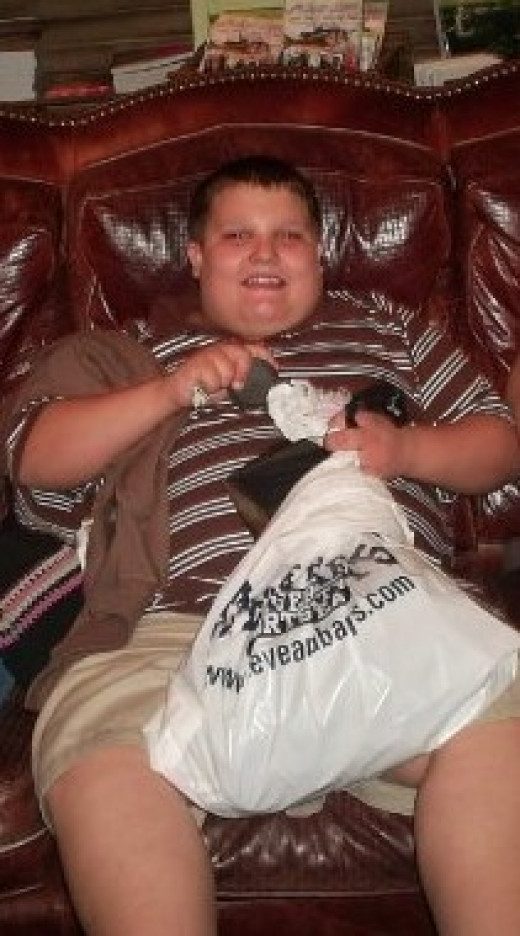 Zachary enjoying shopping between potential outbursts. Kids with Autism can still lead fully functional lives.