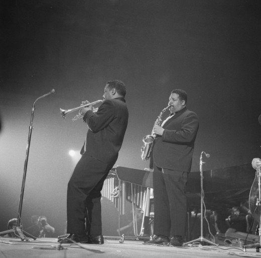 Jazz saxophone player, Cannonball Adderley performing in in Amsterdam, Netherlands, 1961 with his cornet playing brother.  Originally from Tampa, Cannonball later moved to Tallahassee and Fort Lauderdale, Florida, before moving to New York in 1955.
