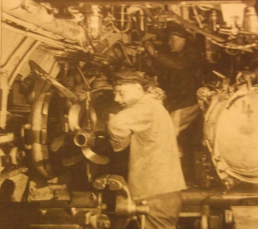 The cramped interior of a typical torpedo room shows the submariner's living conditions.