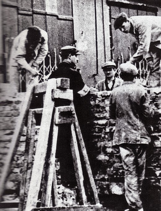 Nazi's forced the Jews to construct the walls around the Warsaw Ghetto.