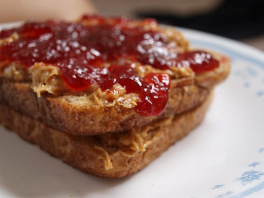 Peanut butter and jelly sandwich (PBJ) on wholemeal bread.