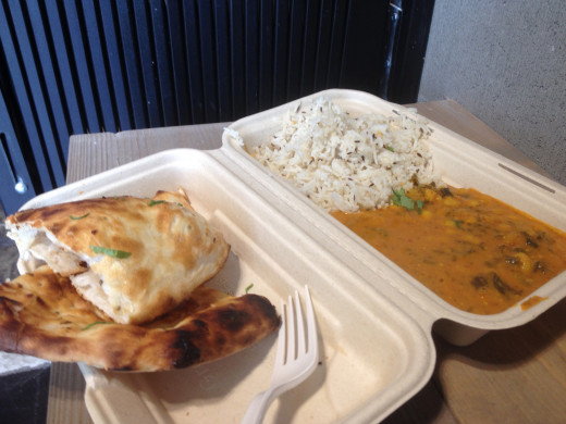 Lentil curry with rice and pita bread.