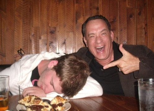 Actor Tom Hanks, right, and a buddy, visited a nearby bar when Hanks was not working, and both got pretty intoxicated, but Hanks' buddy passed out leaving Hanks to laugh at him.