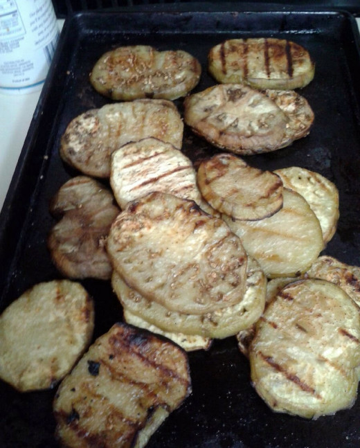 The grilled eggplant slices are recipe ready.