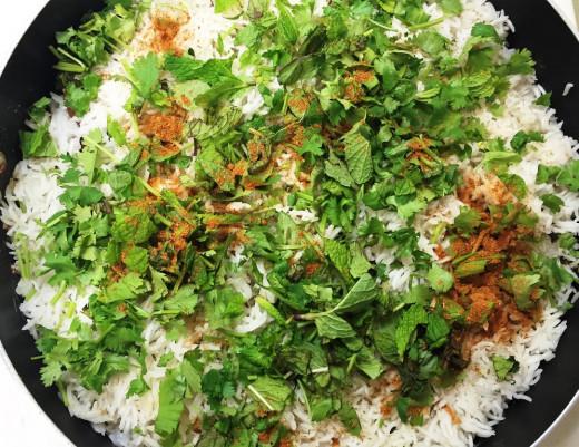 Add coriander leaves, mint leaves, garam masala powder and fried onions.