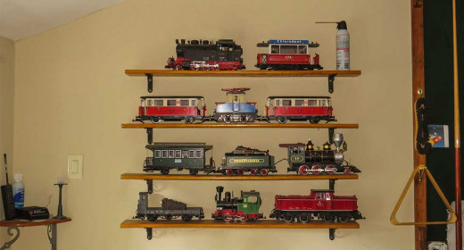 Models are stored inside on our train wall in an entertainment room.