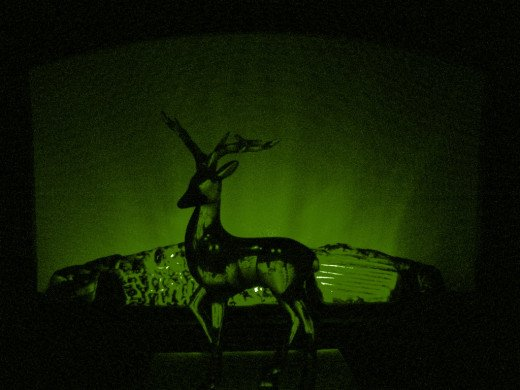 Mine love stags. One from his kitchen table altar. And yes, he loves green and black.