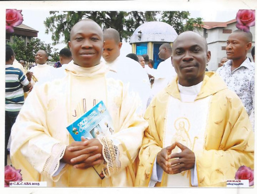 priest-brother from the same town Fr. Peter Claver Anucha and I after ordination of Aba Diocesan Priests at Christ the King Cathedral, Aba,  Nigeria on July 11, 2015/ The Ordaining Prelate was Archbishop Fortunatus Nwachukwu, Apostolic Nigeria