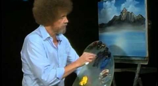 Bob Ross at work painting Mighty Mountain Lake