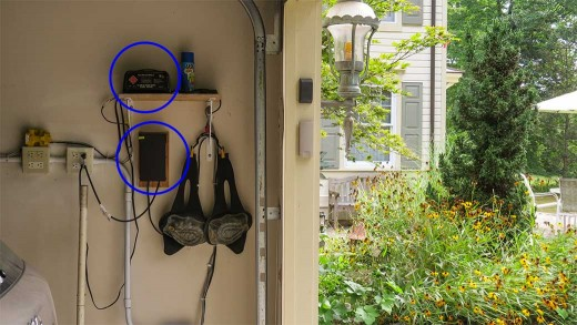 Our controls located in garage, with transformers (circled) for trains & outdoor lighting. Knee pads dangle from a hook, within easy reach of our train garden (to right).