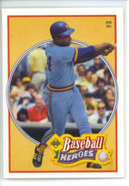 Hank Aaron on a baseball card showing him slugging in a Brewers uniform.