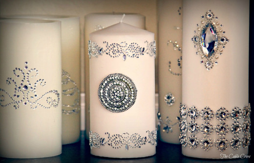 Wedding candles decorated with crystals.