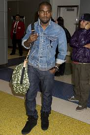 Kanye West wearing different shades of jeans