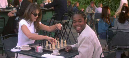 Elisabeth Hurley & Gabriel Casseus playing chess