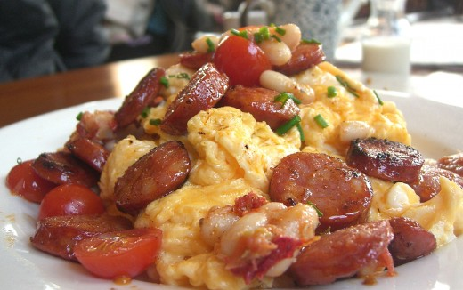 Scrambled eggs is a delightful snack, breakfast treat. Learn how to make it properly with stellar flavors. | Source:  Alpha [CC BY-SA 2.0] https://commons.wikimedia.org/wiki/File%3AScrambled_eggs_with_chorizo%2C_cannelini_beans_and_cherry_tomato.jpg