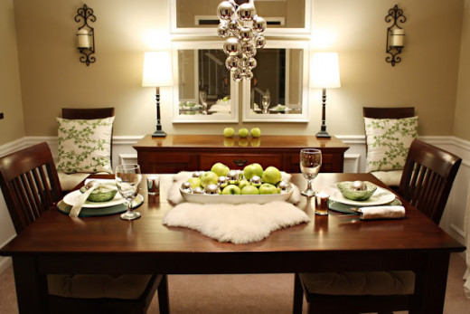 Fill a tray or casserole dish with green apples and silver oranments. Add a table runner and chair pillows in similar colors.