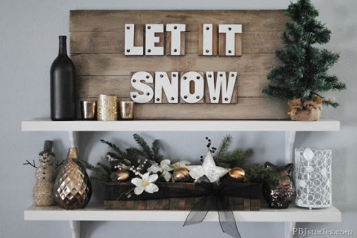 Fill your shelves with a wooden 'Let it Snow' sign. Add natural looking candle holders and greenery.