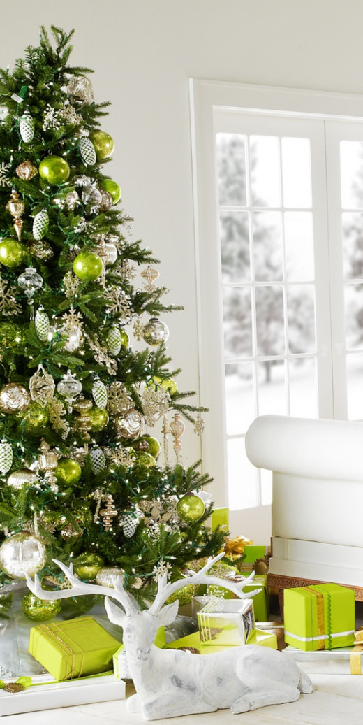Decorate your tree and room with shades of green. Add in decorations and oranments in white and gold to add contrast.