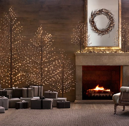 Opt for a more modern approach with a sleek fake lighted tree (or trees). Wrap your presents in dark neutral colors to let the tree really shine.