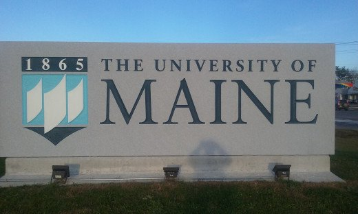 The sign marks the entrance to campus.