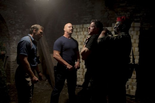 "Former wrestler Austin (centre) punches above his weight in ""The Expendables"""