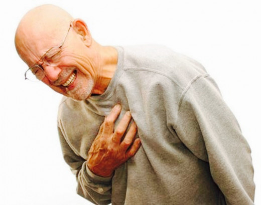 Man reacting to the Excruciating Pain in Chest Region.