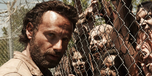Rick Grimes is the lead fictional character in The Walking Dead. Pictured here in Series 4 facing down some Zombies at the prison.