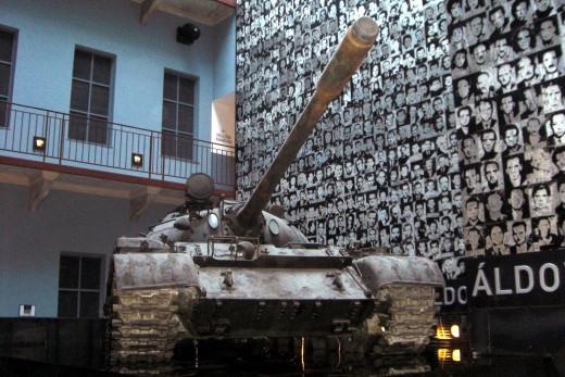 The inner courtyard of today's house of Terror, with the wall of victims and a Soviet T-34.​