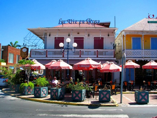 Outdoor cafes like this one in Marigot have better weather in April and July.