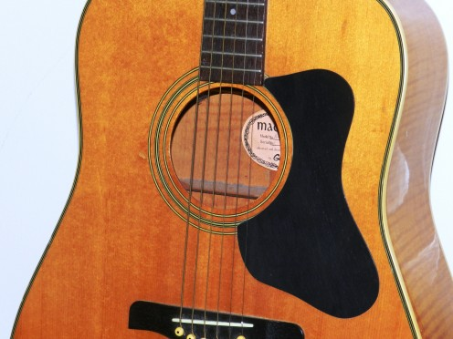 Acoustic guitars depend a sound chamber to amplify the sound of the strings.