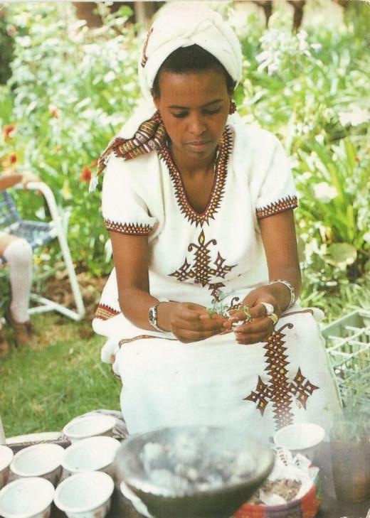 Eritrean woman preparing for coffee ceremony