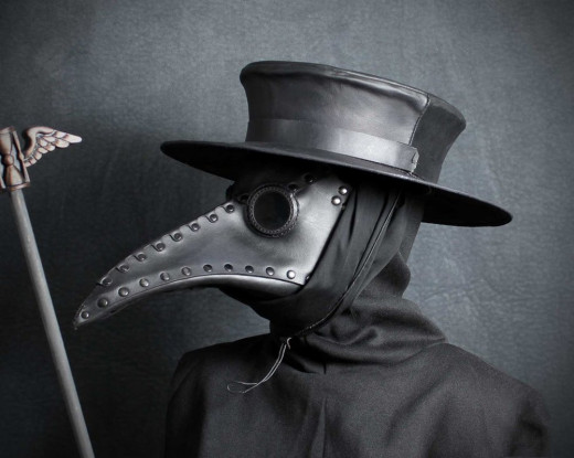 "The clothing identifies the person as a ""plague doctor"" and is intended as protection"