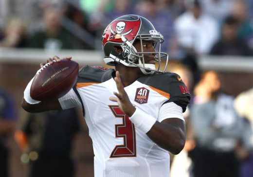 Tampa Bay Buccaneers QB Jameis Winston holding a football, not crab legs