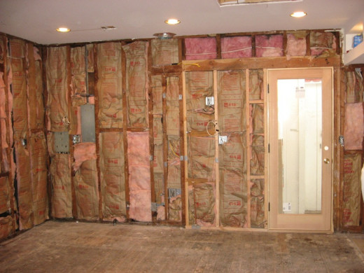 Pink insulation inside of walls. Notice the vapor shield is facing in towards the house.